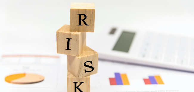 "Four blocks stacked on each other to spell ""risk."" The subject of the UMB Private Wealth Management webinar"